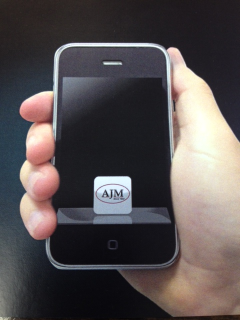 image of mobile phone with ajm app open